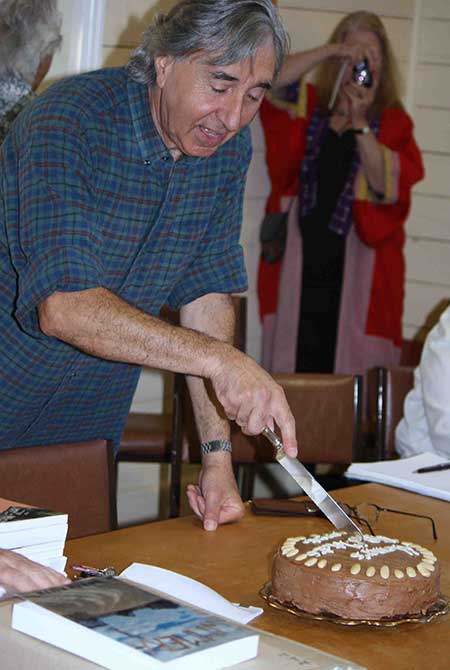 Homer Rieth cutting the cake at the Minyip launch of 150 Motets